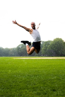Long shot of man jumping in park
