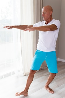 Long shot of man stretching