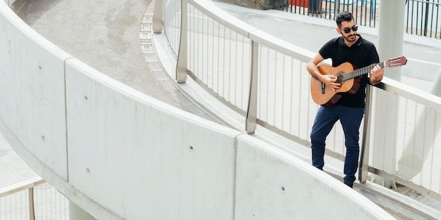 Long shot of musician playing saxophone concept