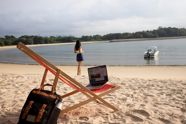 Long shot nomad woman at seaside