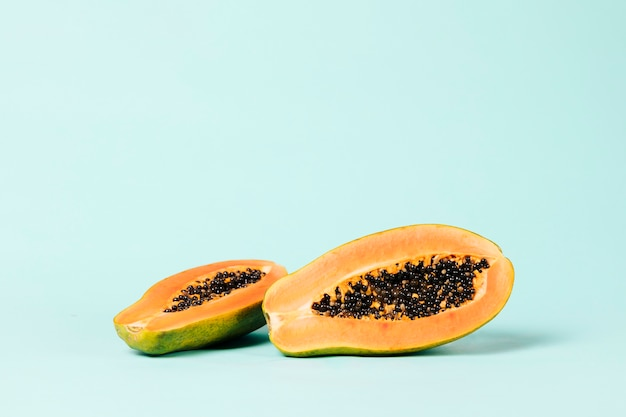 Long shot of papaya fruit on blue background