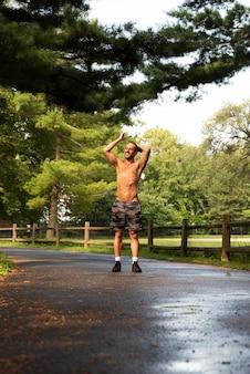 Long shot of runner in park