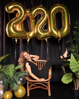 Long shot of a woman in a black suit new year 2020 party