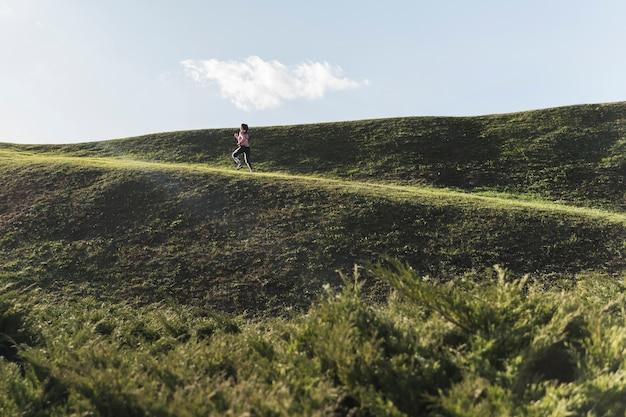 Long shot woman jogging outdoor