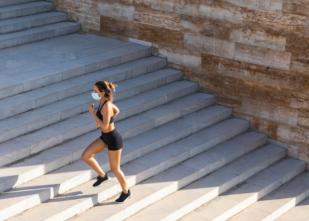 Long shot woman running on stairs