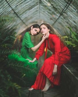 Long shot of women sitting in a green house