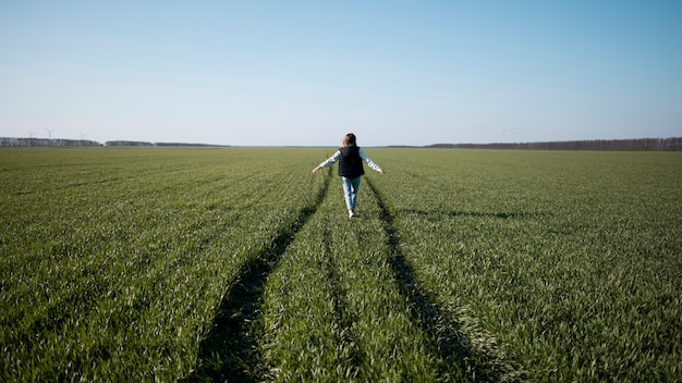 Long shot of young girl in the field