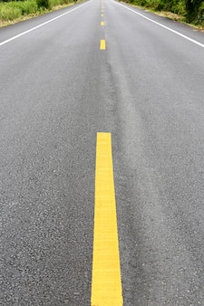 Long straight road with yellow line painted