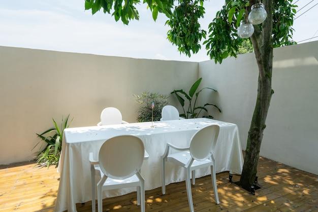 Long table and chair in villa garden restaurant