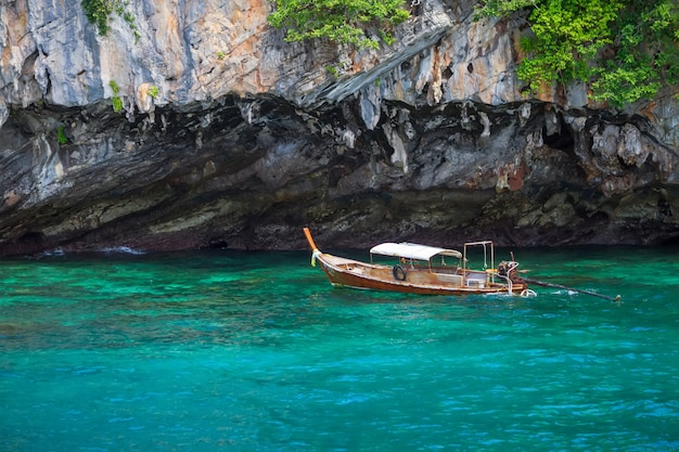 Long tail boat floating on the blue sea in thailand