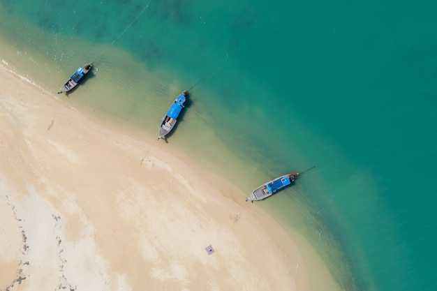 Long tail boat on the sand beach