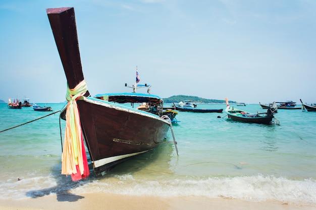 Long tail boat at sunrise beach in phuket