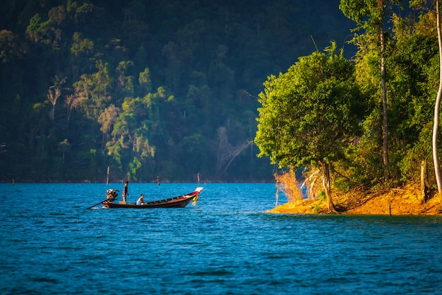 Long tail boat travel at ratchaprapha dam, guilin, thailand