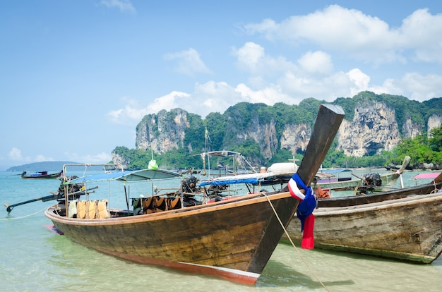 Long tail boats in railay beach in krabi, thailand.