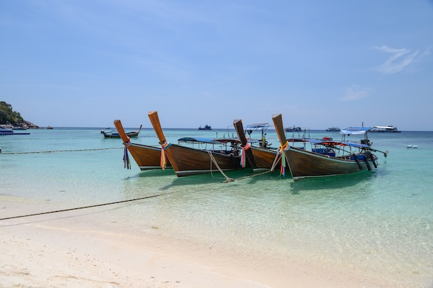 Long-tail wooden boats anchored on tropical sea in andaman