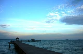 Long tropical pier at sunset