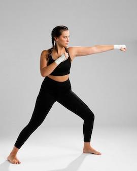 Long view of  karate woman exercising