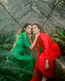Long view portrait of women holding each other