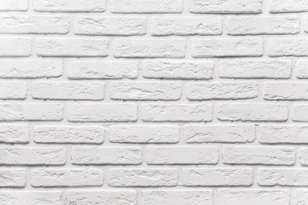 Long white brick wall background. the texture of the old brick painted with white paint
