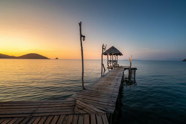Long wooden bridge in beautiful tropical island beach