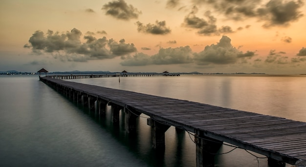 Long wooden bridge pavilion in beautiful tropical island beach