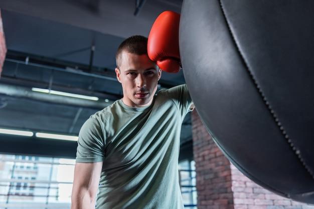 Long workout. good-looking muscle dark-haired athlete enjoying his long workout during weekend