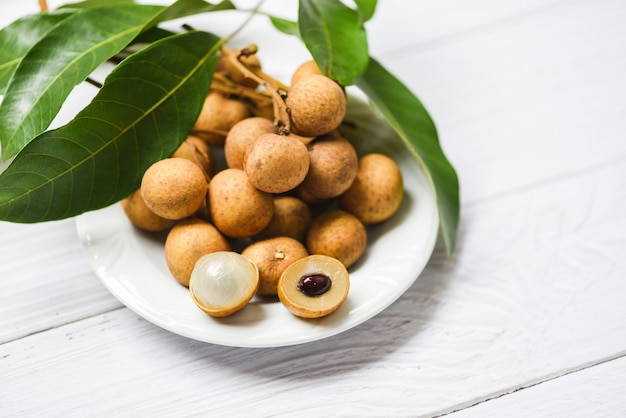 Longan fresh tropical fruit and green leaf in thailand