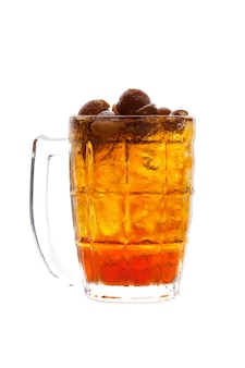 Longan juice with ice in glass isolated on white background.