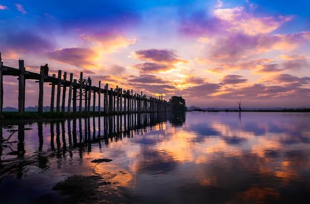 The longest teak bridge u bein at sunrise in mandalay, myanmar.