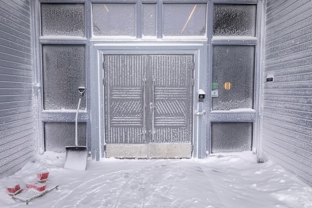 Longyearbyen, svalbard - march 2019: entrance of radisson blu polar hotel spitsbergen covered with snow and frost