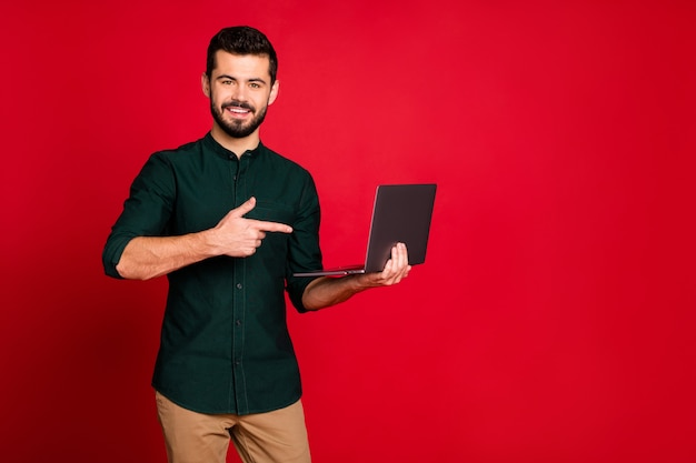 Look black firday discounts! positive cheerful guy use computer find shopping blog information point finger recommend advise wear brown pants trousers