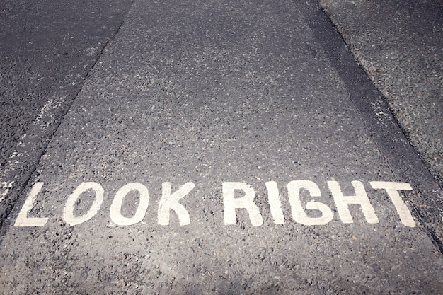Look right warning painted on the tarmac in london, england, uk, ireland.