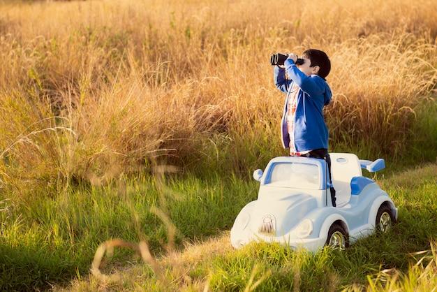 Looking away through binoculars on an adventurous trip of discovery
