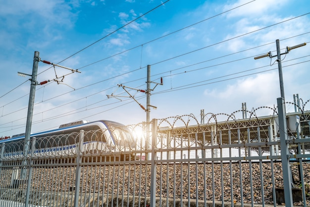 Looking at the high-speed rail transportation through the fence