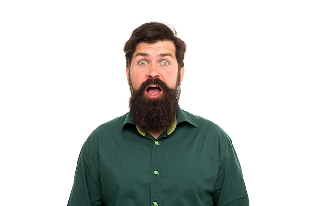 Looking surprised. surprised hipster isolated on white. bearded man keep mouth open with surprise. shocking news. barbershop. hair salon. skincare cosmetics. haircare products. barbering and grooming.