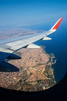 Looking through window aircraft during flight in wing lands over istanbul in sunny weather