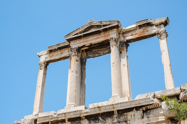 Looking up view of famous greek temple pillars against clear blue sky in temple of zeus, greece