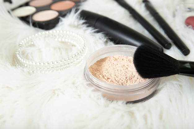 Loose powder and brush close-up. decorative cosmetics.