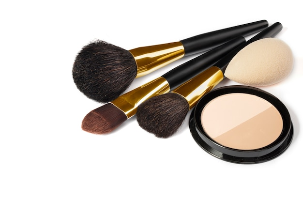 Loose powder, various makeup brushes. makeup artist accessories isolated. products for perfect facial skin makeup.