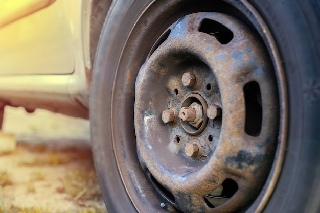 Loosening wheel nuts on the street emergency wheel replacement on the road