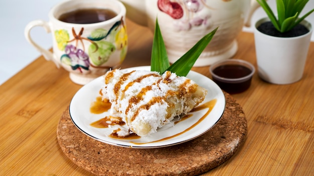 Lopis is a traditional indonesian cake made from glutinous rice grated coconut and palm sugar
