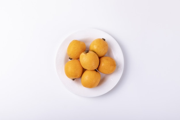 Loquat fruits isolated on a white table
