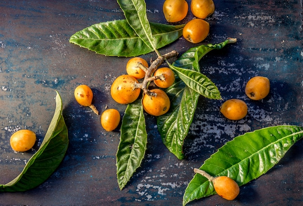 Loquat with fresh leaves on a table