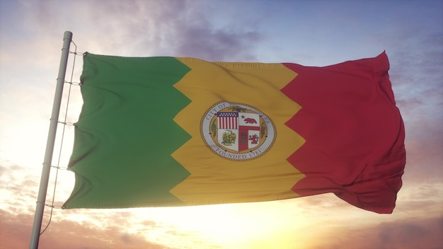 Los angeles city flag, california, waving in the wind, sky and sun background. 3d rendering