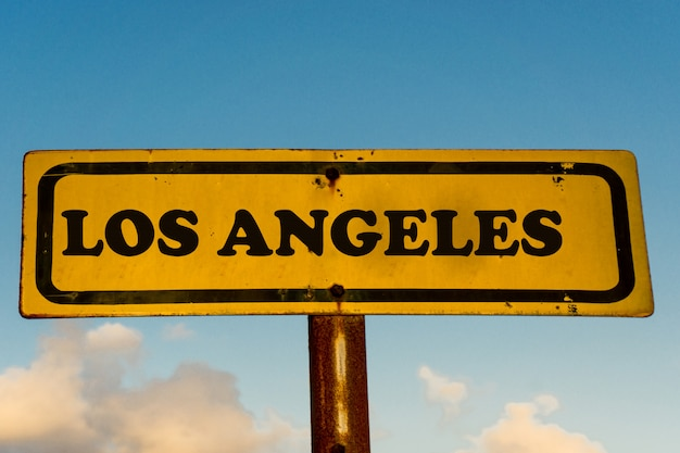 Los angeles city old yellow sign with blue sky