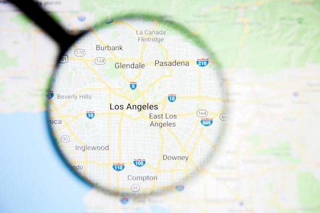 Los angeles city visualization illustrative concept on display screen through magnifying glass
