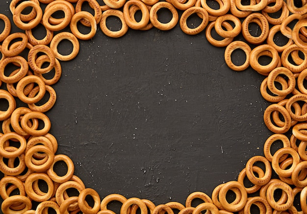 A lot of bakery products bagels on dark background