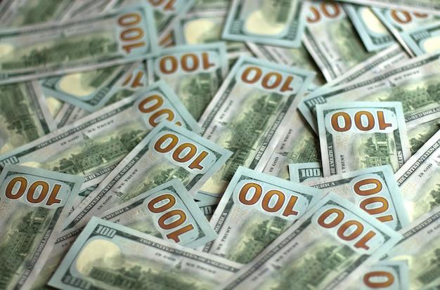 A lot of bills in 100 dollars