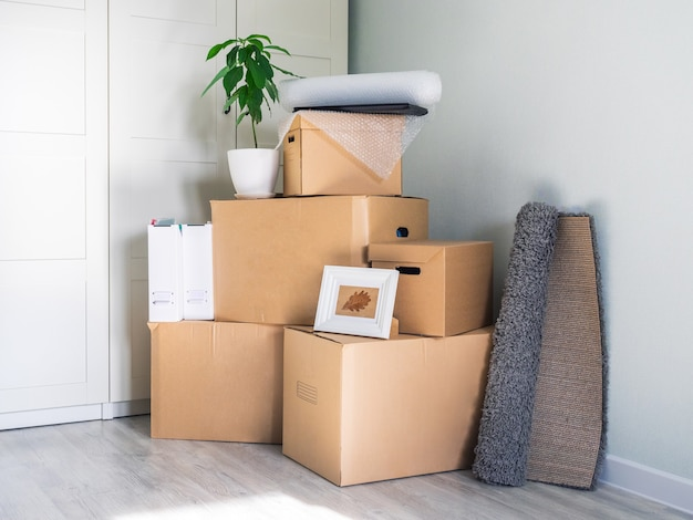 A lot of boxes are in an empty room, preparing to move.