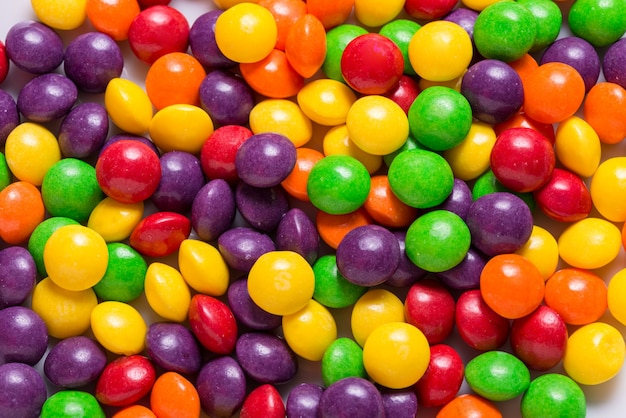 Lot of bright sweet candy, colored background